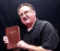 Pastor Kelley holding a bible